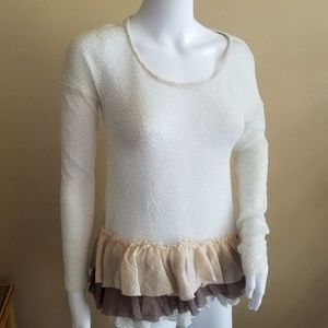 A reve anthropologie lace and ruffled top.